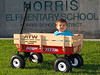 Donovan going for a ride in his new red wagon